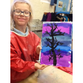 A finished piece of art with the proud artist.