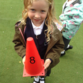 Child finds the number 8 on a cone.