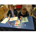 Children use paints to create a blossom painting.