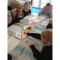 children investigate exploding colours.