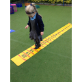 Child counting and jumping on a numberline.