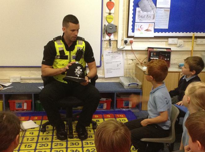Policeman talking to children