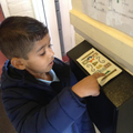 Child finds number 1 on Class 1 letterbox.