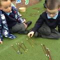 Children count sticks in a tally.