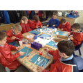Children create pictures of the 3 ships.