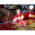 Children make flames for the buring houses.