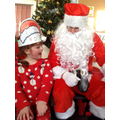 Santa speaks to a child about their Christmas list