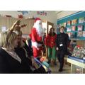 Santa & his Head Elf arrive at School