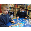 Children building jigsaws.