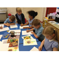Children sketch and use pastels to draw sunflowers