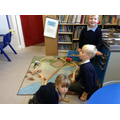 Children in breakfast club playing with train set.