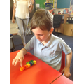 Using cubes to find number bonds to 10.