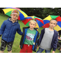Children with umbrella hats on ready to set off.