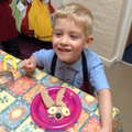 Child with his finished Knuffle Bunny sandwich.