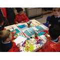 Children use poster paint to create their painting