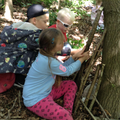 Children building a den for a small animal.