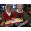 Using the magnetic letters to spell words.