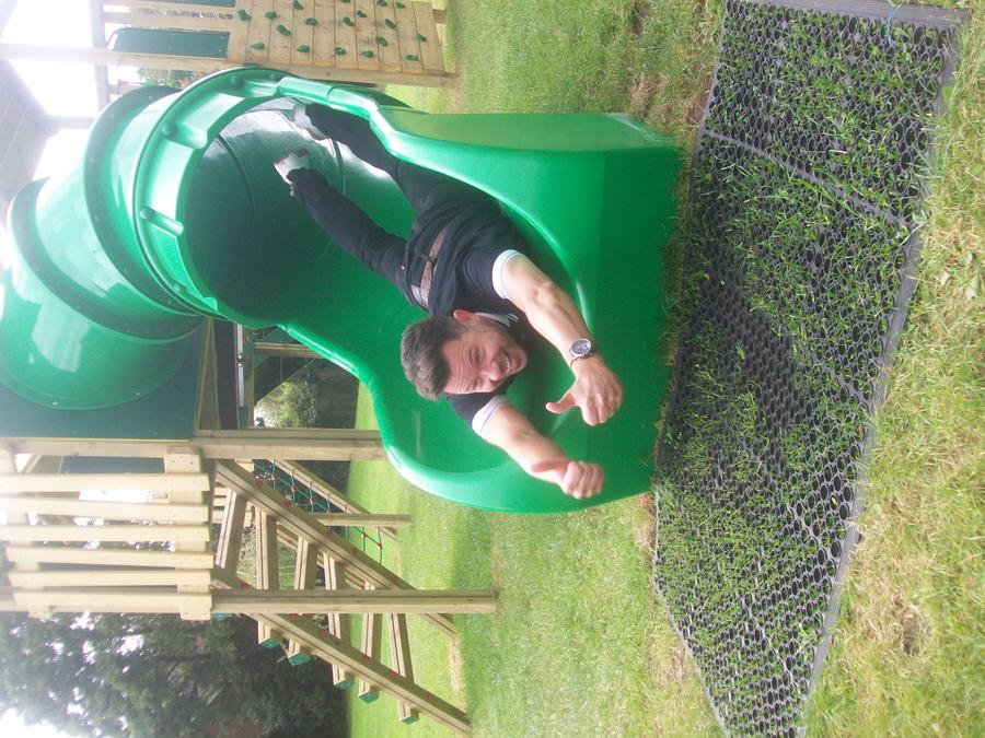 Guy Bass trying out our new slide