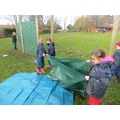 The children worked together to make a canopy.