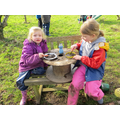 Making some delicious meals in the mud kitchen.