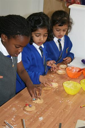 Decorating funny face biscuits