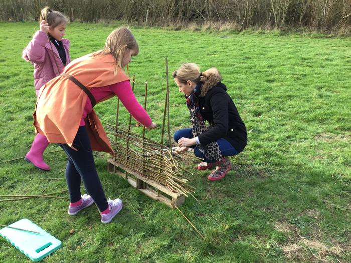 Making 'wattle', the weaving for the roundhouse