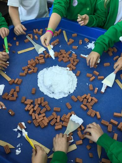 Creating mini houses with the foam! Funky fingers!