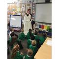 Mrs Tasker showed us her wedding dress and photos.