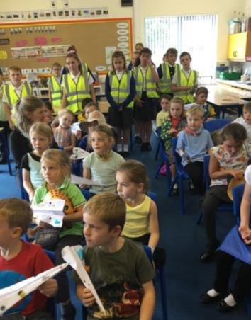 Y6 supporting Y1 on their 'day trip to Africa'