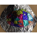At home, Freya experimented with cubism using sharpie pens on tin foil.
