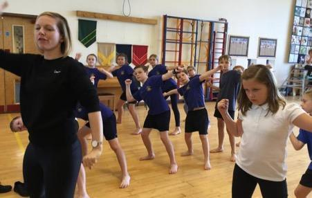 Teacher from Churchill Academy supporting the creation of an Anglo Saxon inspired dance