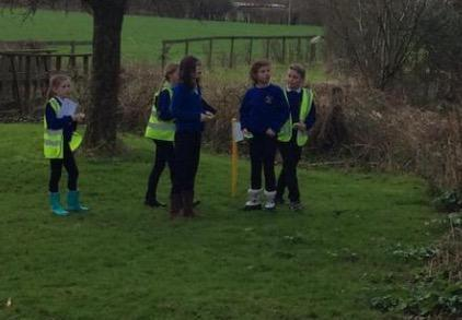Learning to use a compass at Lower Stock Farm