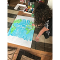 Mia is busy completing her Climate Change project