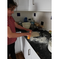 Catherine making pizza for her book menu