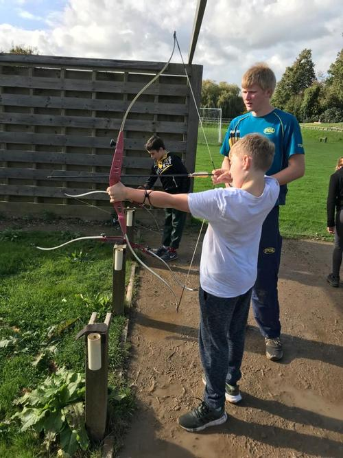 Archery, trapeze and groups songs on today's menu!