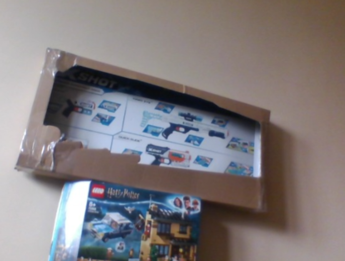 Alex has cleverly made a TV with boxes!