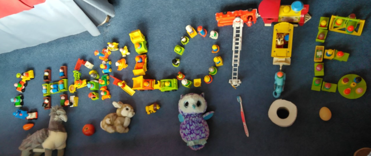 Charlotte's name, using little people, and items that start with each letter!