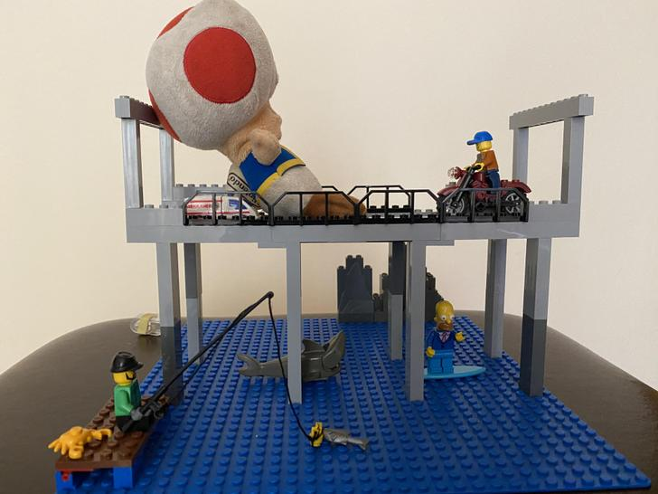 Good thing Seth has built a super sturdy Lego bridge as there is a shark below!!!