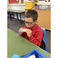 We made Peruvian Panpipes using straws.