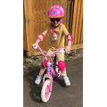 Lauren riding her bike - with NO stabilisers! FAB!