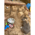 Sand castles in my new sandpit - Leo and Nya