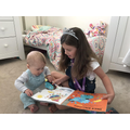 Emily reading to he little brother.