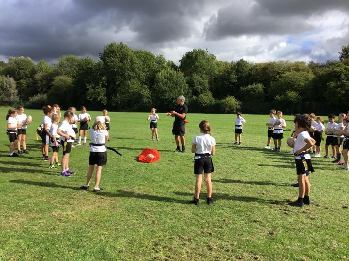 Year 4 children developing their rugby skills
