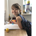 Ava is happy completing her home learning