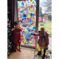 Talia has finished painting the window!