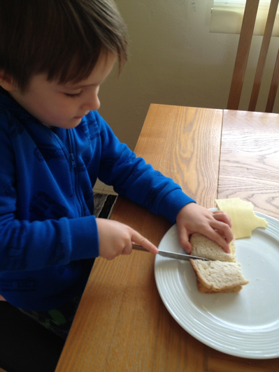 Charlie making his lunch.