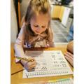 Elsa is completing Maths work