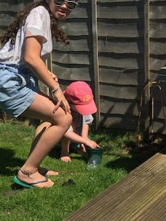 Olina (and Logan) enjoy the garden