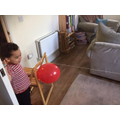 Aston carrying out science experiments