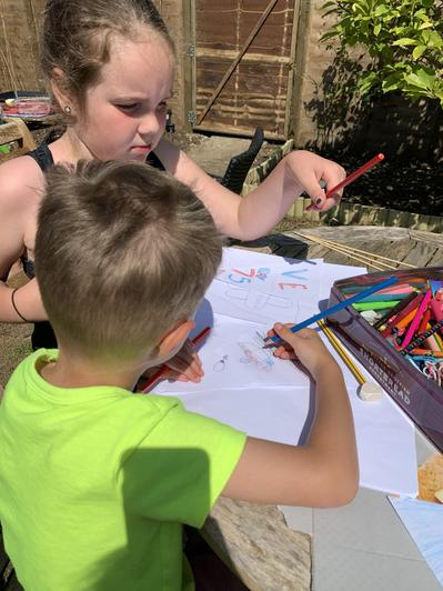 Jacob and his big sister making flags together.